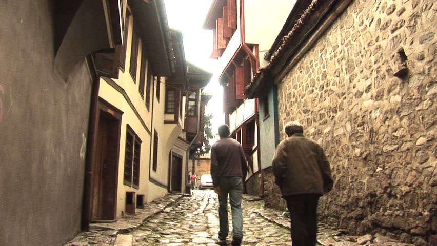 2 people walking down a street in Plovdiv