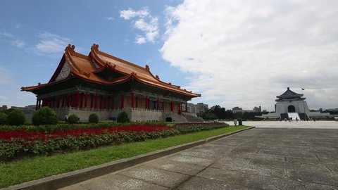 People walking around the entrance gate to the National Music Hall and the Chiang Kai Shek memorial hall in a beautiful sunny day in Taipei, Taiwan-Dan
