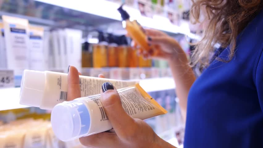 Woman Buying Body Care Products in Supermarket #17201827