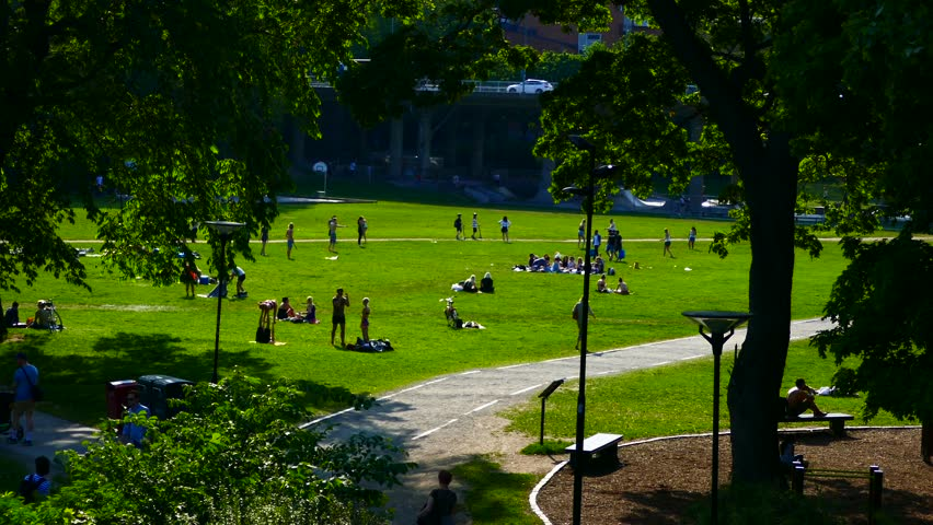 STOCKHOLM, SWEDEN, JUNE 2016: Long shot of unrecognized crowd of people enjoying summer and sunbathing in the sun in a park - picnic  | Shutterstock HD Video #17213776