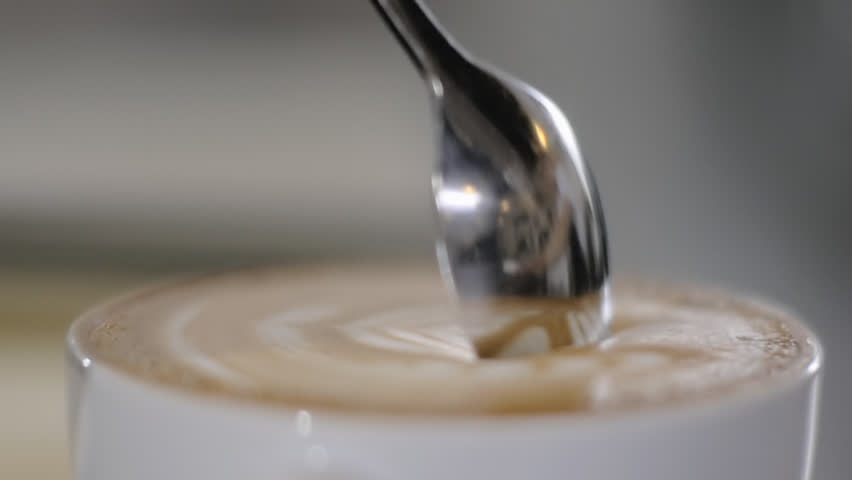Cup of Coffee. Stirring with spoon. Close up of a beautiful coffee. Stirring with spoon.  Royalty-Free Stock Footage #17233849