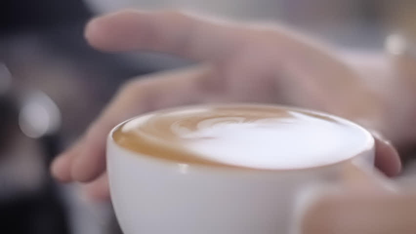 Full Cup of Coffee. Slow Motion Close Up. Close up of a beautiful coffee. Ready to serve. Form slowly moving on top.   #17233858