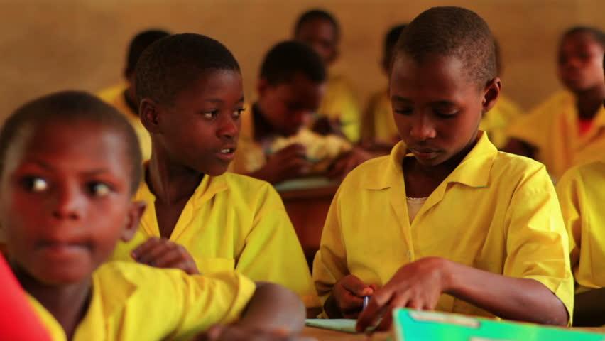 KENYA, AFRICA - CIRCA 2011: Close up of school boys in class in Kenya, Africa.