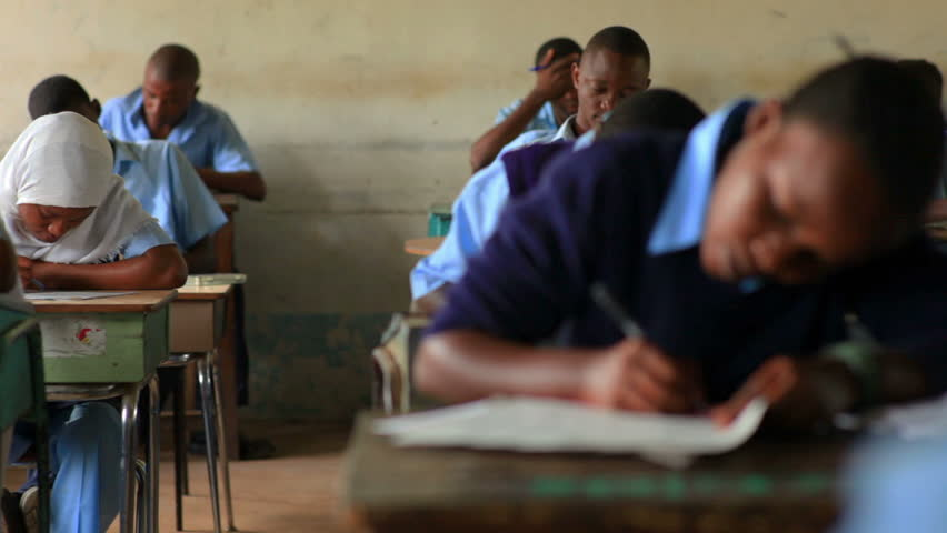 MOMBASSA, KENYA, AFRICA - CIRCA 2011: Students taking a test in class in a school in a village in Kenya