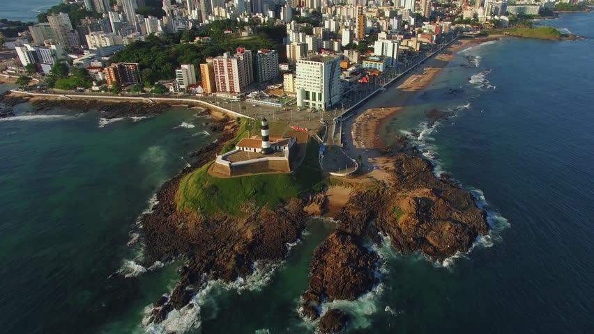 Aerial view of Salvador, Bahia, Brazil, tilt up from Farol da Barra lighthouse to Salvador cityscape.
