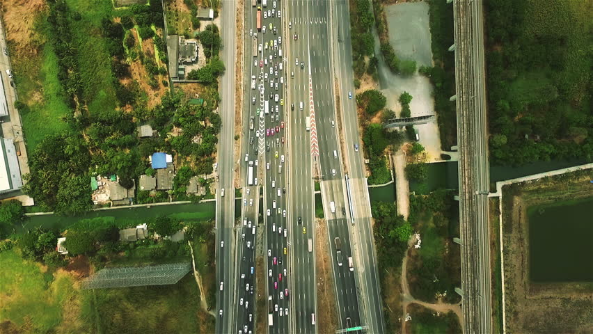 Aerial view above Motorway & Ring Roads Inter-Change Systems on the Outskirt of Bangkok, Thailand. | Shutterstock HD Video #17285950