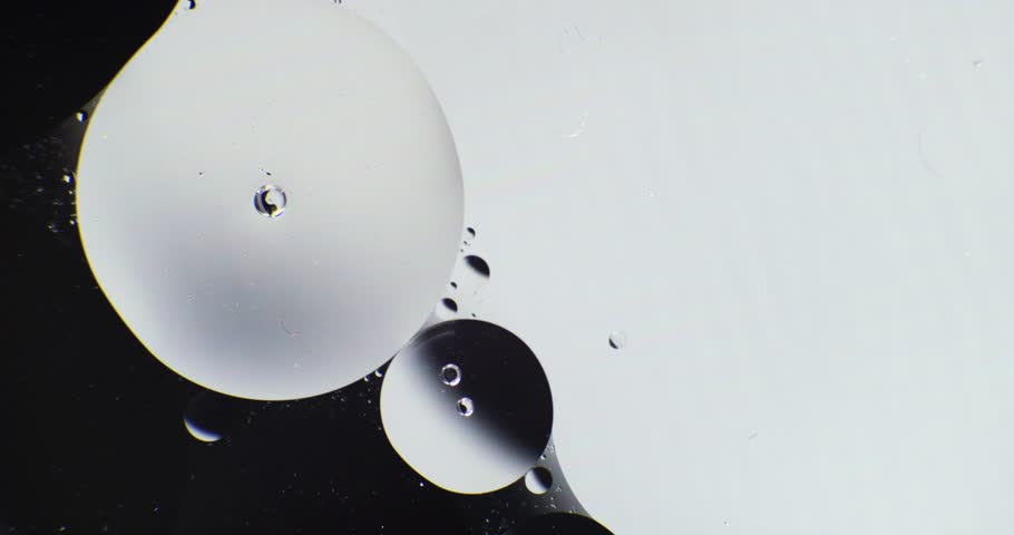 Macro. Oil babbles on  water, abstraction video.