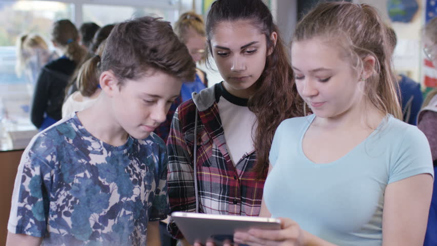 4K Portrait of teens looking at tablet computer in school science class. Shot on RED Epic. UK - April, 2016 #17295259
