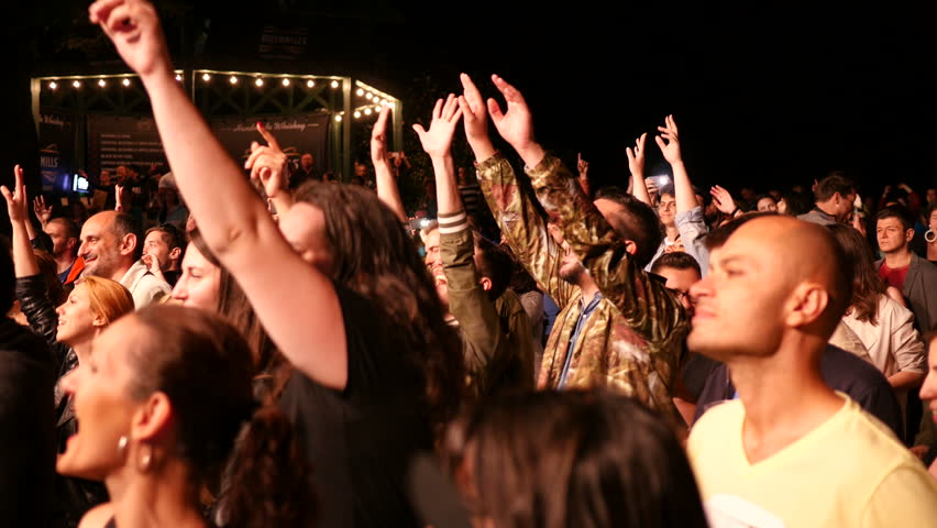 SOFIA, BULGARIA - JUN 10, 2016: Free public music concert. Cheering crowd spectators enjoy a music concert clapping by a stage   Shutterstock HD Video #17297050
