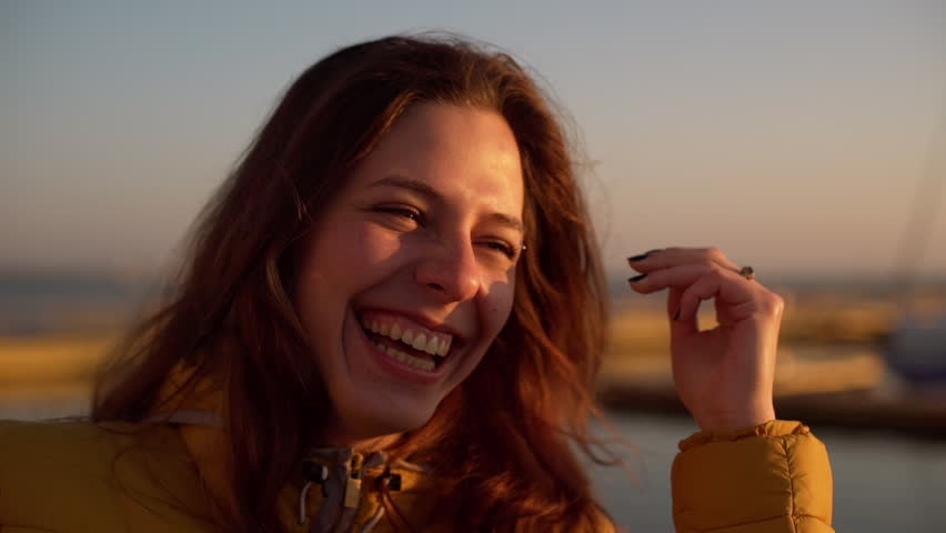Young beautiful girl laughing near sea. Close up. Slow motion. | Shutterstock HD Video #17311891