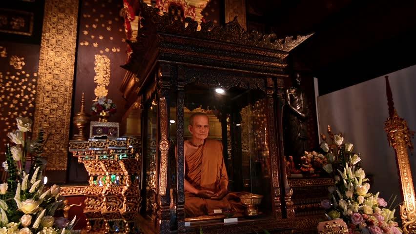 Buddha and monk tribute in Wat Chiang Mai temple. Chiang Mai, Thailand   Shutterstock HD Video #17318815