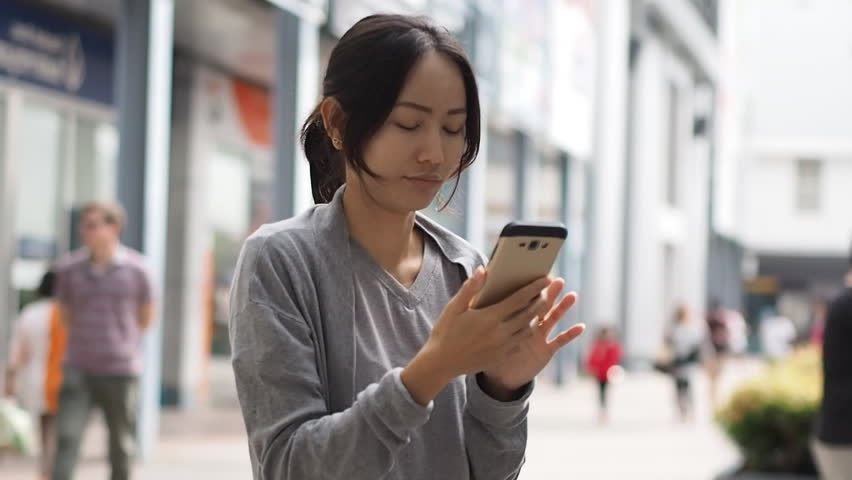 Asian woman texting on cellphone smartphone | Shutterstock HD Video #17366419