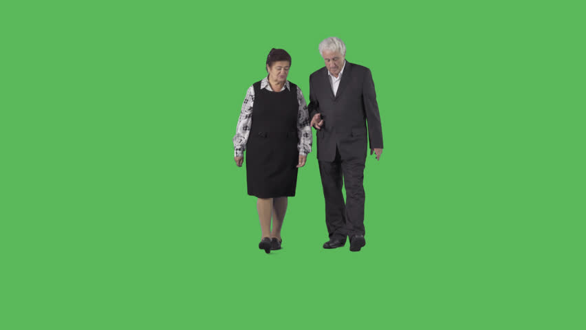 Senior man & woman in black clothes are walking at the camera and discussing. Camera is static. Lens 85 mm. Footage with alpha channel. File format - .mov, codec PNG+Alpha