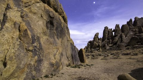 3 axis motion controlled time lapse with dolly in, tilt up, pan right & zoom out motion of stars over moonlit rocky desert at Alabama Hills in California