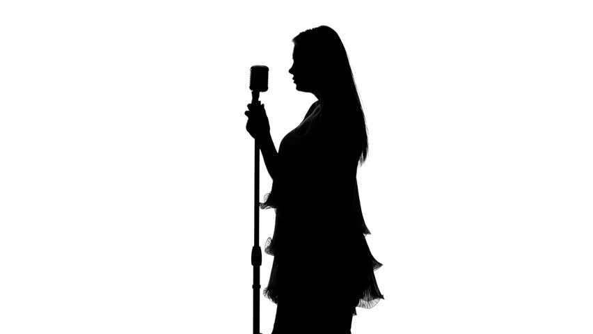 Girl in short dress singing the song in the hall. Silhouette. White