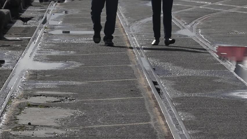 Silhouette of couple legs walks on a pier | Shutterstock HD Video #17412679