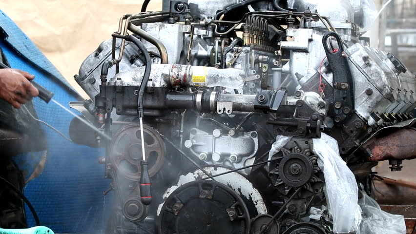 A man cleaning boat engine with high pressure water jet | Shutterstock HD Video #17418031