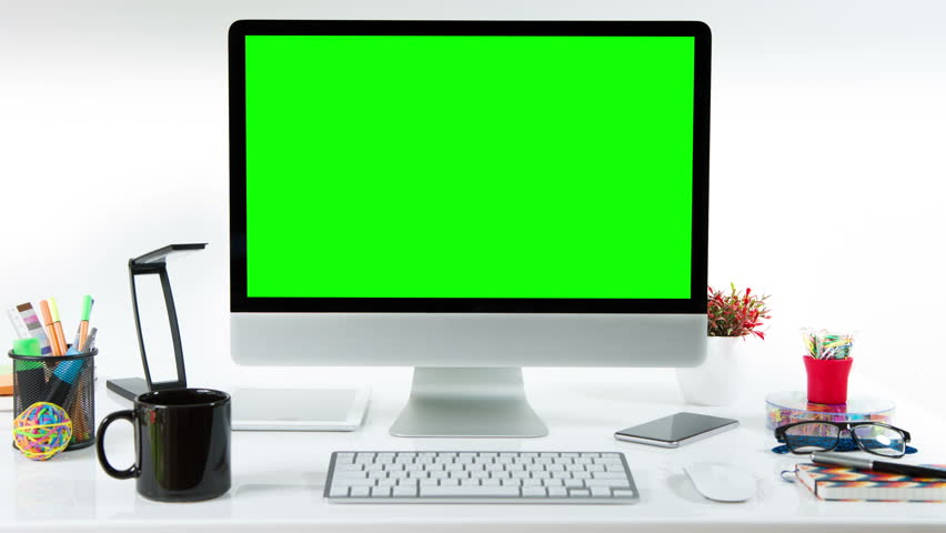Computer desk with colorful office elements. Lateral dolly. Chroma Key. Perfect to put your own images or videos. Track with perspective corner pin.      Shutterstock HD Video #17421136