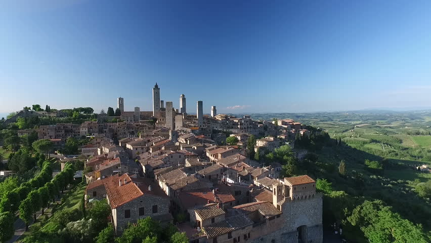 Aerial: Flight over a mediaeval town of Fine Towers, San Gimignano, Tuscany, Italy