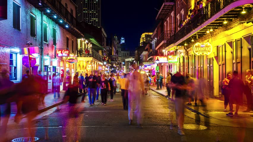 NEW ORLEANS, LOUISIANA - MAY 5th: Unidentified people on Bourbon Street at night in the historic French Quarter of New Orleans, Louisiana on May 5th, 2016.
