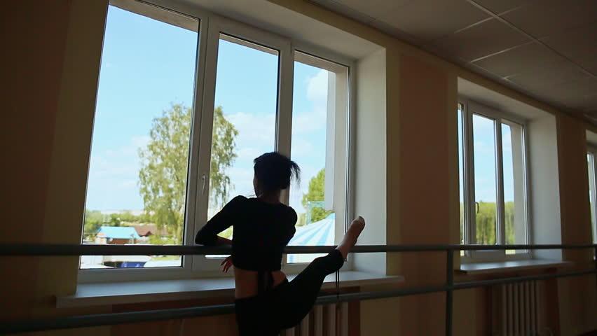 Young beautiful ballerina warming up in ballet class. #17465032