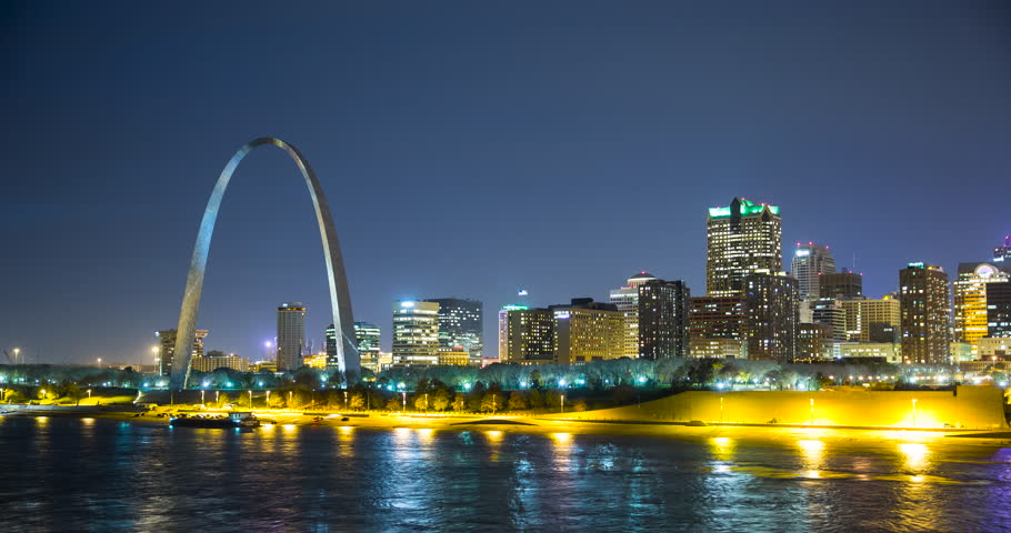St. Louis, Missouri, USA - view of the illuminated city at night with the Gateway Arch monument and the Mississippi River - Timelapse without motion