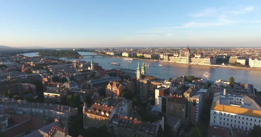 Aerial footage taken from a drone shows the Hungarian Parliament and the river Danube in Budapest sunset. | Shutterstock HD Video #17501341