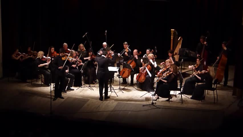 DNIPRO, UKRAINE - JUNE 6, 2016: The famous violinist Eugene Kostritsky and FOUR SEASONS Chamber Orchestra - main conductor Dmitry Logvin perform at the State Russian Drama Theatre