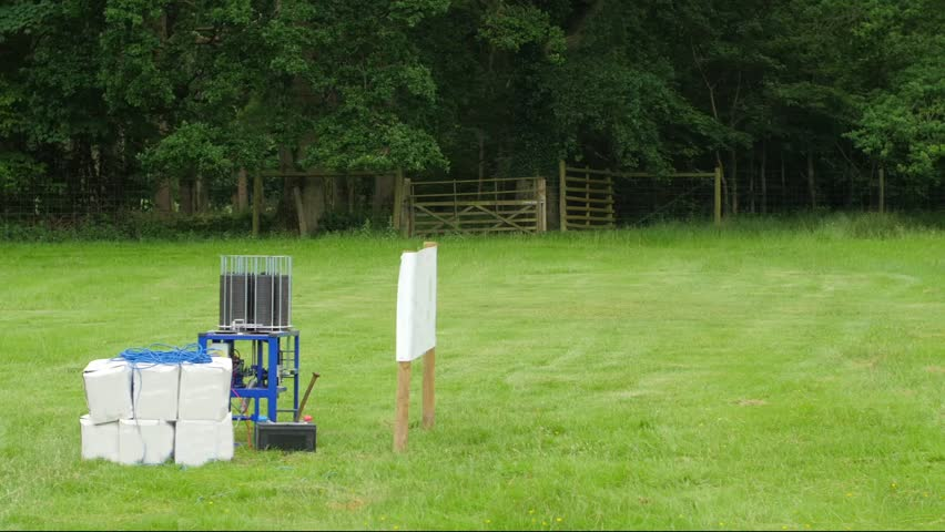 View of automatic trap thrower for clay pigeon shooting low trajectory in action | Shutterstock HD Video #17528416