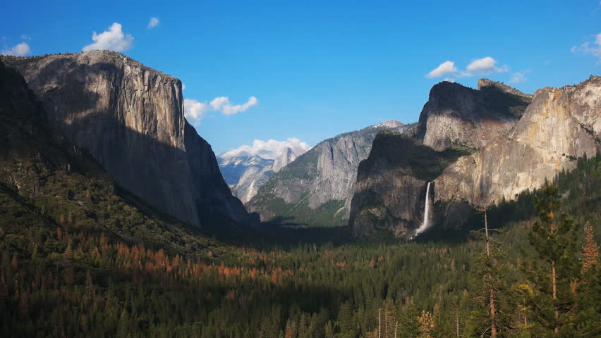 Late afternoon view of bridalveil falls and half dome in yosemite national park from tunnel view | Shutterstock HD Video #17529424