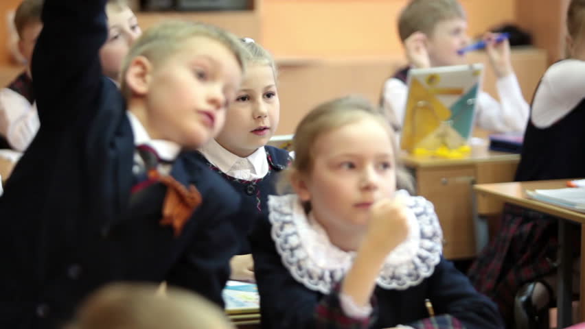 ST. PETERSBURG, RUSSIA - CIRCA MAY, 2016: Schoolchildren listen the teacher while sitting at the desks. Russian elementary school, the lesson | Shutterstock HD Video #17536288