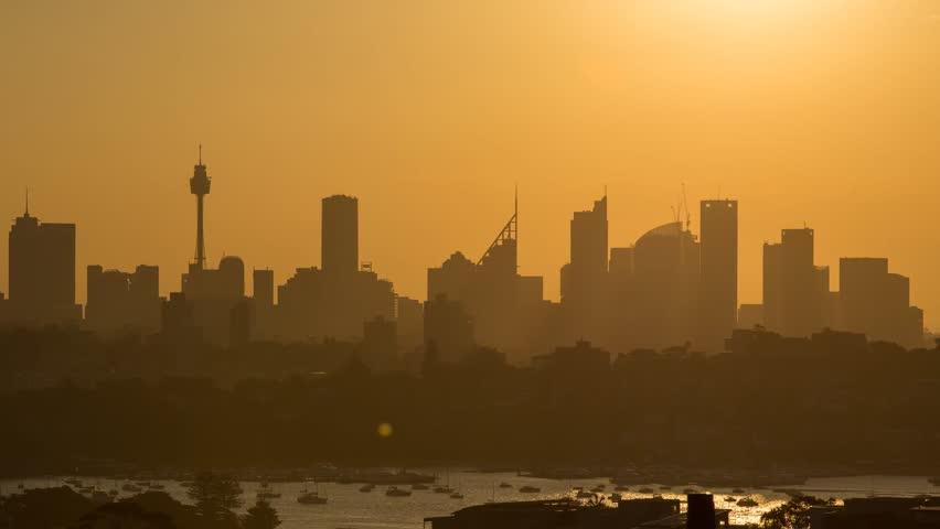 Sunset day to night timelapse over Sydney skyline, Australia.