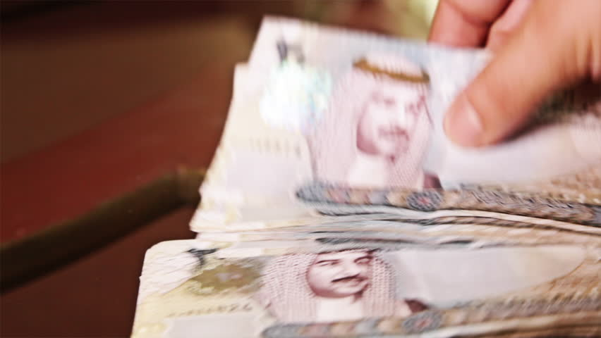 Arab Money Bahrain. Placing wads of bills on a table