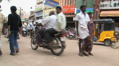 INDIA - CIRCA APRIL, 2011:  Busy Indian street with Rickshaws and motorbikes.