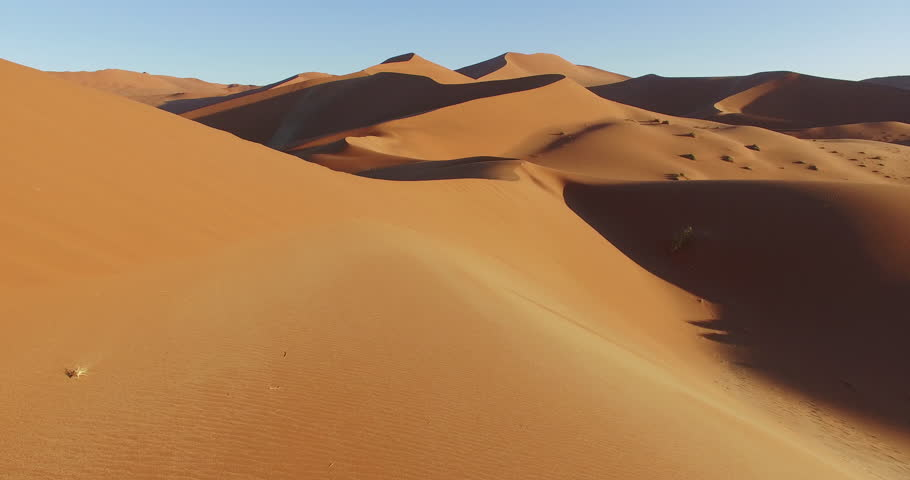 4K aerial view of endless sand dunes of the Namib desert inside the Namib-Naukluft National Park | Shutterstock HD Video #17560171