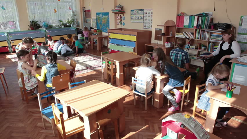 ST. PETERSBURG, RUSSIA - CIRCA MAY, 2015: Time lapse view of children drawing lesson in day-care center. Russian kindergarten is a daycare center for preschool kids
