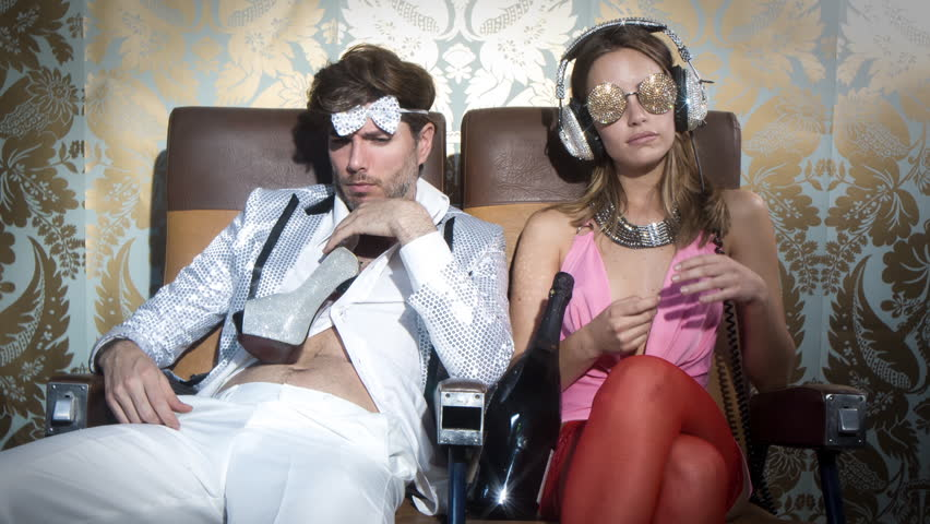 a cool couple after a big night out on the town. the guy is hungover and completely drunk and the woman wants to party more #17582593