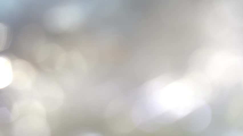 Moving bokeh lights - abstract animation for background - horizontal crossing of light discs from right to left in slow motion - colorful animation in white, pink, red, green, gray pastel colors.