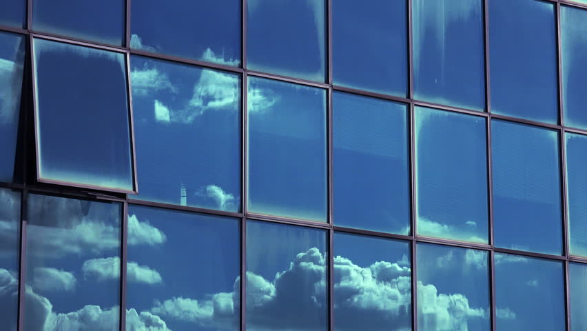 time lapse of Clouds passing over corporate business buildings: particular #17609857