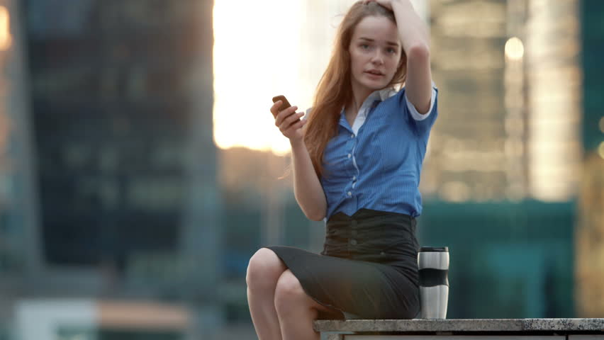 Young happy talking on cellphone in the city | Shutterstock HD Video #17624077