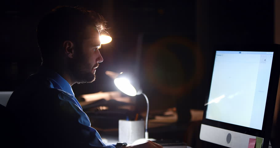 Businessman using computer at night in the office | Shutterstock HD Video #17632450