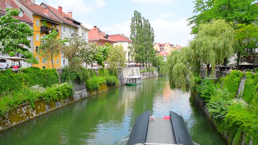 Water transport boat on thr Ljubljanica river in the center of Ljubljana city. Ljubljana is the capital and largest city of Slovenia. Ljubljana is situated in the Ljubljana Basin in Central Slovenia. Royalty-Free Stock Footage #17632876