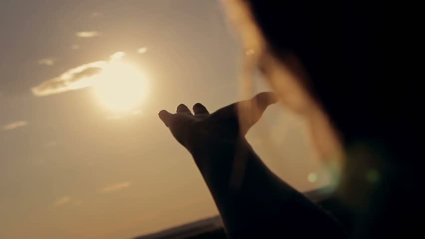 Girl looking at the sunset through her hands | Shutterstock HD Video #17633224