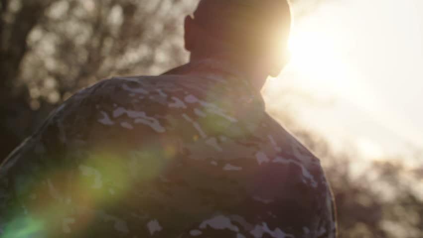 Army soldier walking confident in sunset scene - force diagonal shot