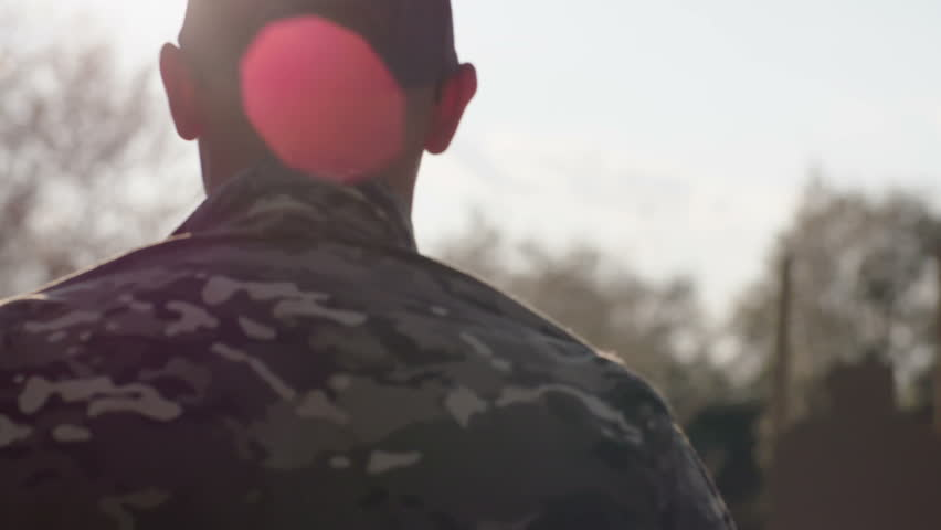 Army soldier walking confident in sunset scene