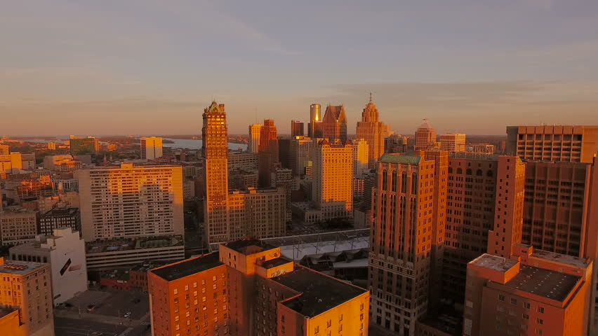 Detroit Aerial v111 Flying low over downtown with cityscape sunset views.