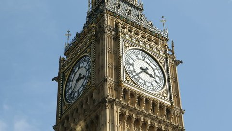 Big Ben Clock Face Time Lapse Stunning time-lapse of the famous Big Ben clock tower showing the dial spinning around racing through time.  Useful for illustrating time passing or a fast paced montage