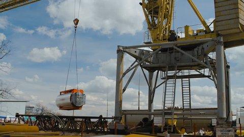 Yellow Hoisting Crane Keeps Cistern