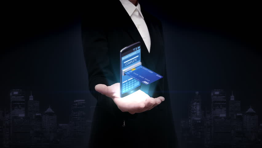 Businesswoman open palms, credit card insert a smartphone, Internet,online payments.mobile purchase.