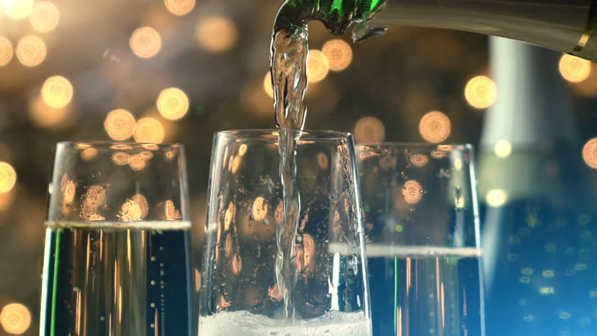 Champagne slow motion pour with Christmas lights and lens flare.   Shutterstock HD Video #17713936